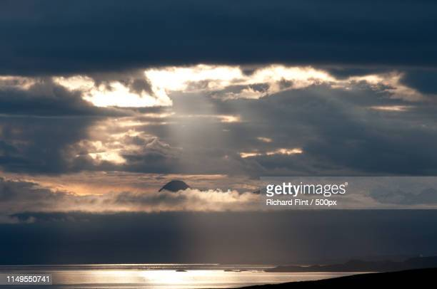 moody sky at sunset above sea - richard flint stock pictures, royalty-free photos & images