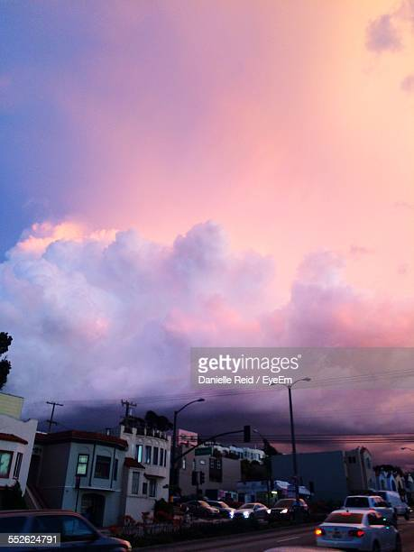 moody sky over city - danielle reid stock pictures, royalty-free photos & images