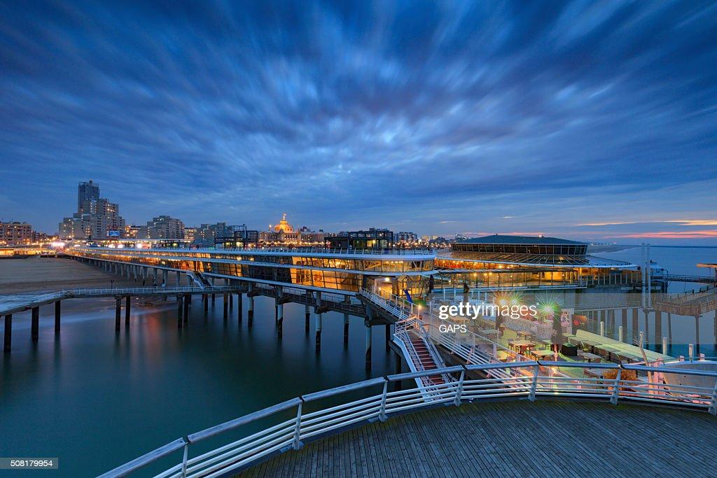 moody sky over the Pier of Scheveningen : Stock Photo