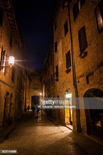 Moody streets of San Gimignano in Italy at nightfall
