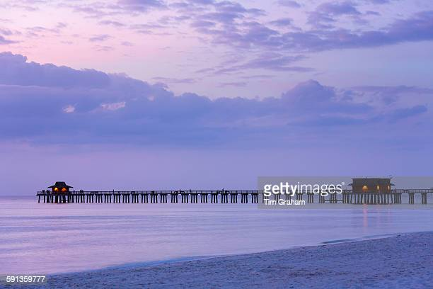 Moody sunset by the pier at Naples beach in Florida United States of America
