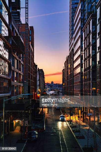 nyc moody sunset - chelsea new york stock photos and pictures