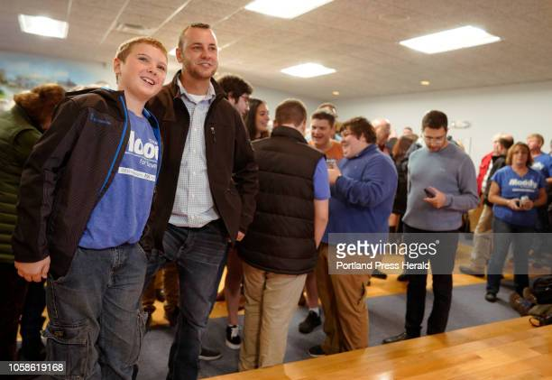 Moody supporters Jackson Faulkner left and his stepfather Mike Fowler watch national election on Tuesday November 6 2018 at Moody's Collision Center...