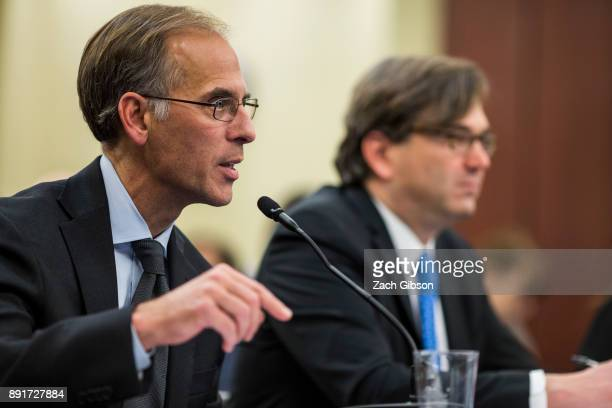 Moody's Analytics Chief Economist Mark Zandi speaks as former Council of Economic Advisers Chairman Jason Furman looks on during a forum held by...