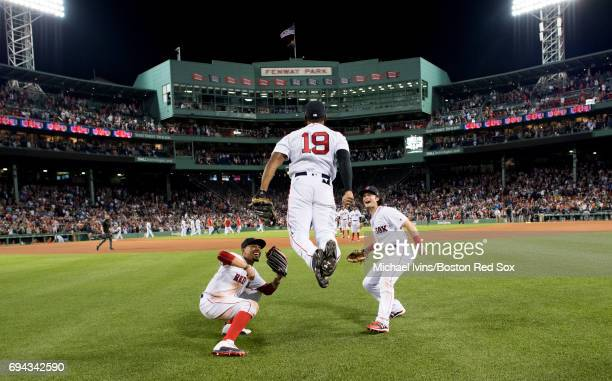 Mookie Betts and Andrew Benintendi react as Jackie Bradley Jr #19 does the 'ski jump' to celebrate his ninth inning home run and a 53 win over the...