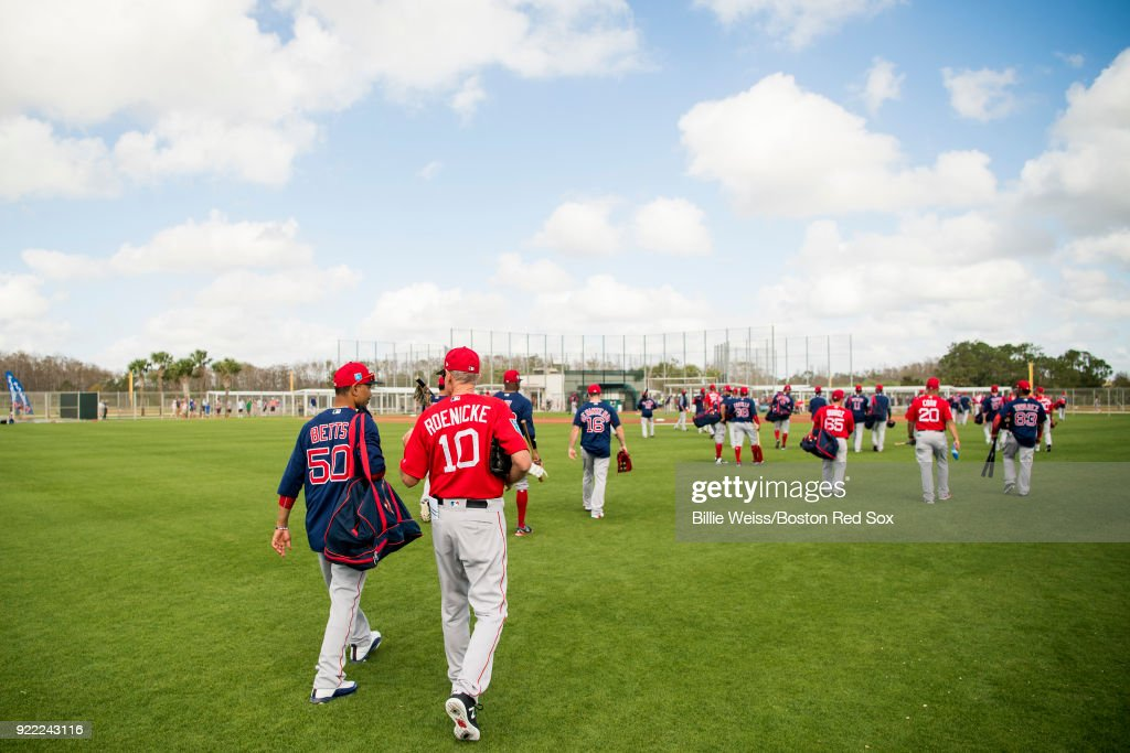 Mookie Betts #50 and bench coach Ron Roenicke of the Boston Red Sox walk on the field during a team workout on February 21, 2018 at jetBlue Park at Fenway South in Fort Myers, Florida .