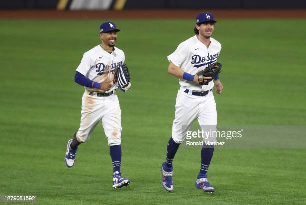 Mookie Betts and Cody Bellinger of the Los Angeles Dodgers react after defeating the San Diego Padres 6-5 in Game Two of the National League Division...