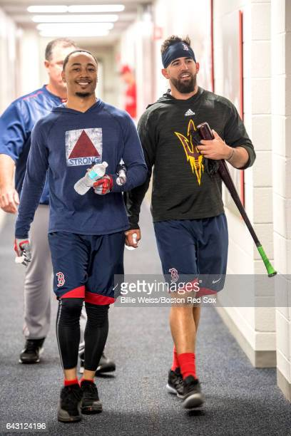 Mookie Betts and Deven Marrero of the Boston Red Sox talk during a team workout on February 20 2017 at Fenway South in Fort Myers Florida