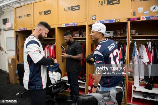 Mookie Betts and Deven Marrero of the Boston Red Sox wear Tom Brady jerseys for the road trop to Baltimore following a game against the Oakland...