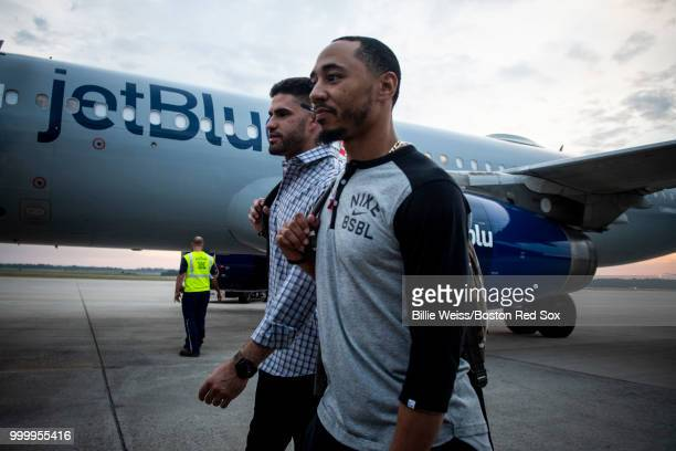 Mookie Betts and JD Martinez of the Boston Red Sox walk outside of the plane during a team charter flight to Washington DC for the 2018 Major League...