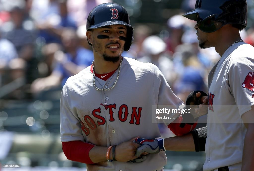 Mookie Betts #50 and teammate Xander Bogaerts #2 of the Boston Red Sox celebrate after Betts scored iduring the first inning at Globe Life Park in Arlington on May 6, 2018 in Arlington, Texas. The Red Sox won 6-1.