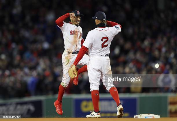 Mookie Betts and Xander Bogaerts of the Boston Red Sox celebrate their teams 42 win over the Los Angeles Dodgers in Game Two of the 2018 World Series...