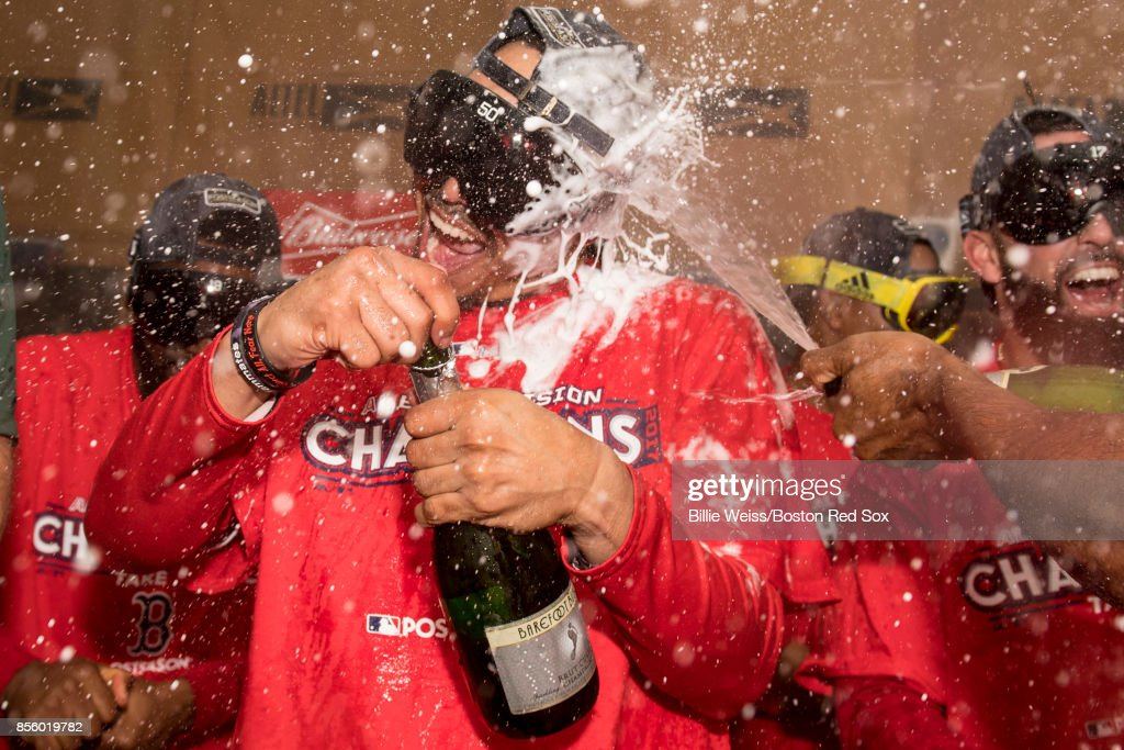Mookie Betts #50 celebrates in the clubhouse after clinching the American League East Division against the Houston Astros on September 30, 2017 at Fenway Park in Boston, Massachusetts.