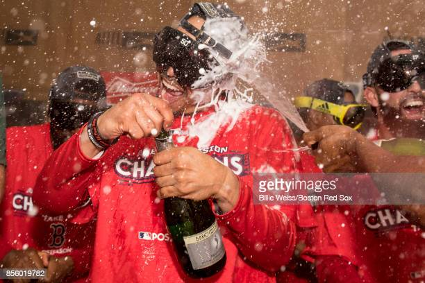 Mookie Betts celebrates in the clubhouse after clinching the American League East Division against the Houston Astros on September 30 2017 at Fenway...