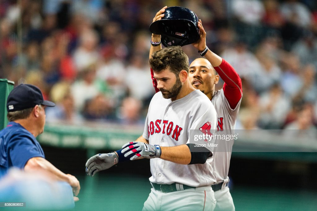 Mookie Betts #50 celebrates with Mitch Moreland #18 of the Boston Red Sox after Moreland hit a solo home run during the fifth inning against the Cleveland Indians at Progressive Field on August 23, 2017 in Cleveland, Ohio.