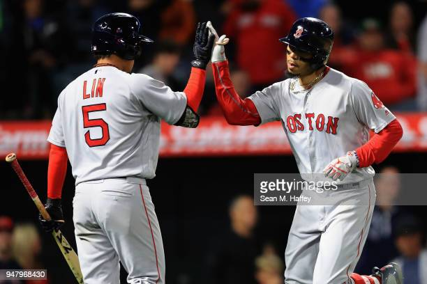 Mookie Betts is congratulated at the plate by TzuWei Lin of the Boston Red Sox after hitting a solo homerun during the eighth inning his third of a...