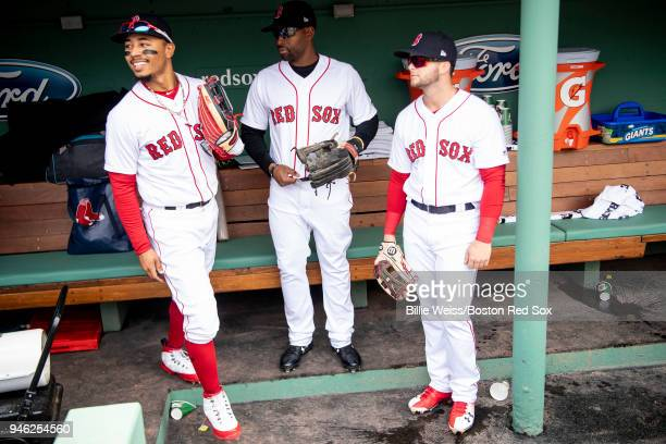 Mookie Betts Jackie Bradley Jr #19 and Andrew Benintendi of the Boston Red Sox react in the dugout before a game against the Baltimore Orioles on...