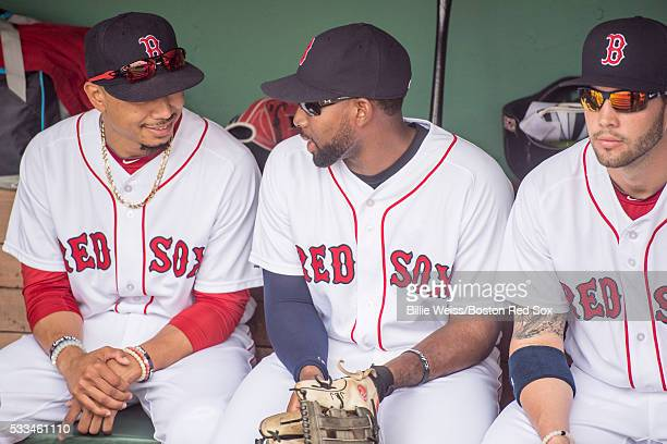 Mookie Betts Jackie Bradley Jr #25 and Blake Swihart of the Boston Red Sox talk in the dugout before a game against the Cleveland Indians on May 22...