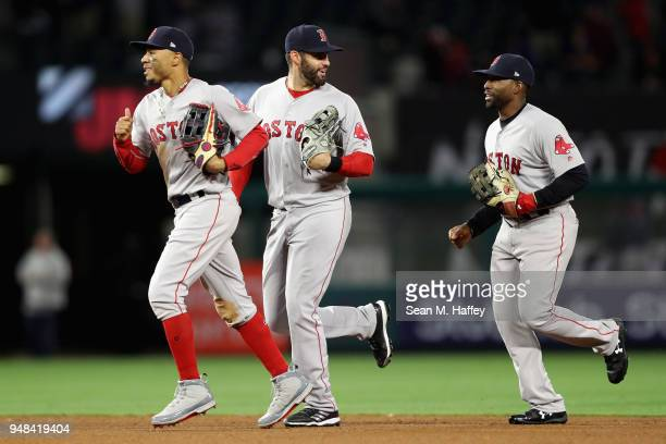 Mookie Betts JD Martinez and Jackie Bradley Jr #19 of the Boston Red Sox celebrate as they run off the field after defeating the Los Angeles Angels...