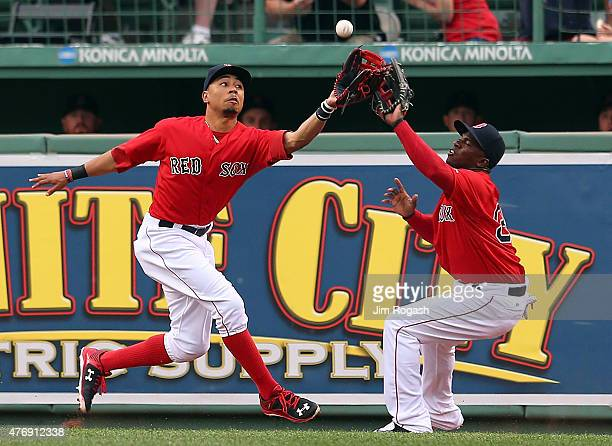 Mookie Betts of the Boston Red Sox almost collides with Rusney Castillo of the Boston Red Sox but makes the catch during the first inning during a...