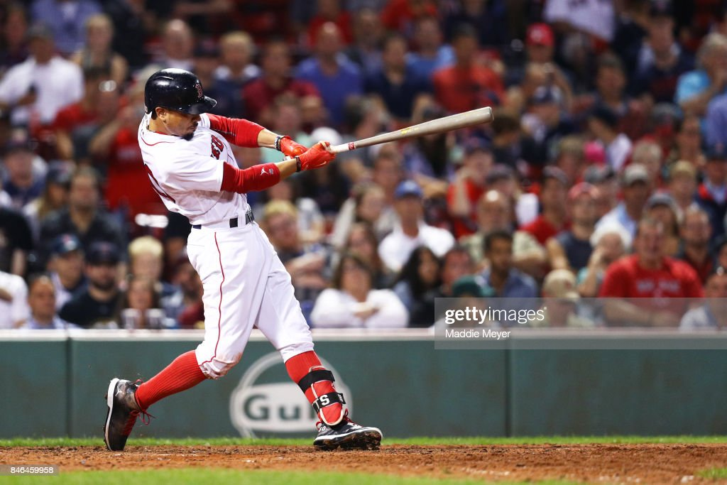Mookie Betts #50 of the Boston Red Sox at bat during the eighth inning against the Oakland Athletics at Fenway Park on September 12, 2017 in Boston, Massachusetts.