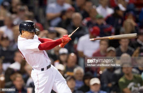 Mookie Betts of the Boston Red Sox breaks his bat on a ground out against the Houston Astros in the sixth inning at Fenway Park on September 28 2017...