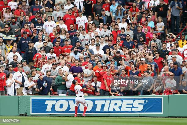 Mookie Betts of the Boston Red Sox catches a ball hit by Josh Reddick of the Houston Astros in the second inning during game three of the American...
