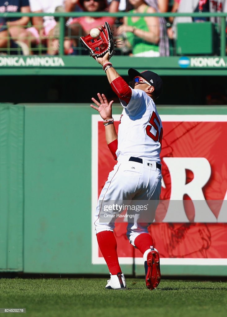 Mookie Betts #50 of the Boston Red Sox catches a line drive in the top of the eighth inning during the game against the Kansas City Royals at Fenway Park on July 30, 2017 in Boston, Massachusetts.