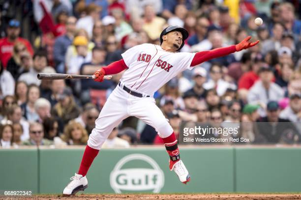 Mookie Betts of the Boston Red Sox catches a pitch that skipped off the dirt while batting during the sixth inning of a game against the Tampa Bay...
