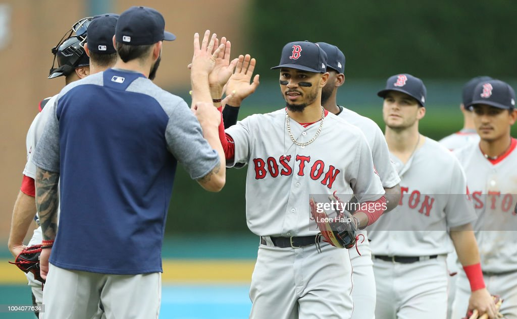 Mookie Betts #50 of the Boston Red Sox celebrates a win over the Detroit Tigers at Comerica Park on July 22, 2018 in Detroit, Michigan. Boston defeated Detroit 9-1.