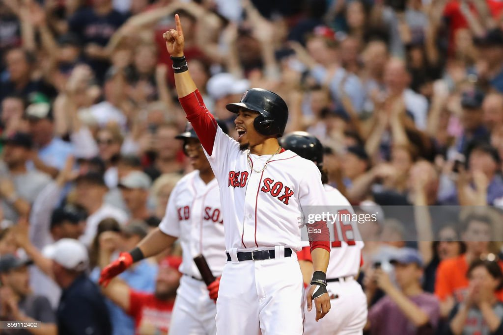 Mookie Betts #50 of the Boston Red Sox celebrates after a two-run RBI double by Hanley Ramirez #13 (not pictured) in the seventh inning against the Houston Astros during game three of the American League Division Series at Fenway Park on October 8, 2017 in Boston, Massachusetts.