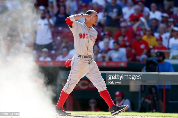 Mookie Betts of the Boston Red Sox celebrates after scoring the goahead run in the eighth inning of the game against the Cincinnati Reds at Great...