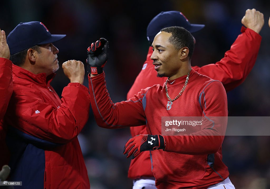 Mookie Betts #50 of the Boston Red Sox celebrates after singling in the winning run in the ninth inning against the Toronto Blue Jays at Fenway Park April 27, 2015 in Boston, Massachusetts.