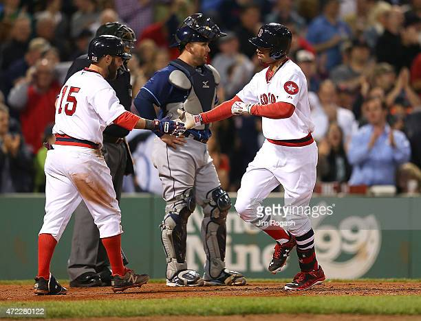 Mookie Betts of the Boston Red Sox celebrates his home run with Dustin Pedroia against Tampa Bay Rays in the sixth inning at Fenway Park May 5 2015...