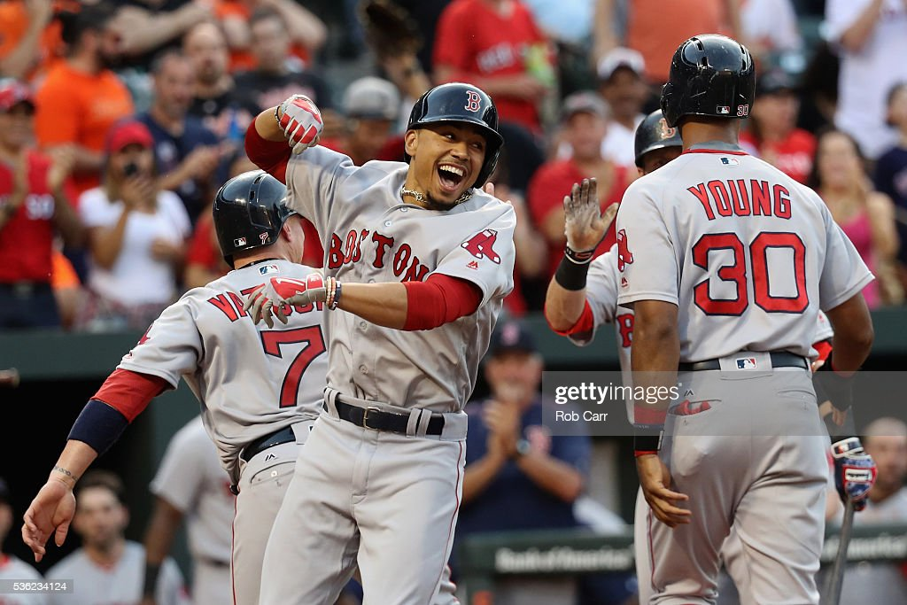 Mookie Betts #50 of the Boston Red Sox (L) celebrates with Chris Young #30 after hitting a three run homer against the Baltimore Orioles in the second inning at Oriole Park at Camden Yards on May 31, 2016 in Baltimore, Maryland.