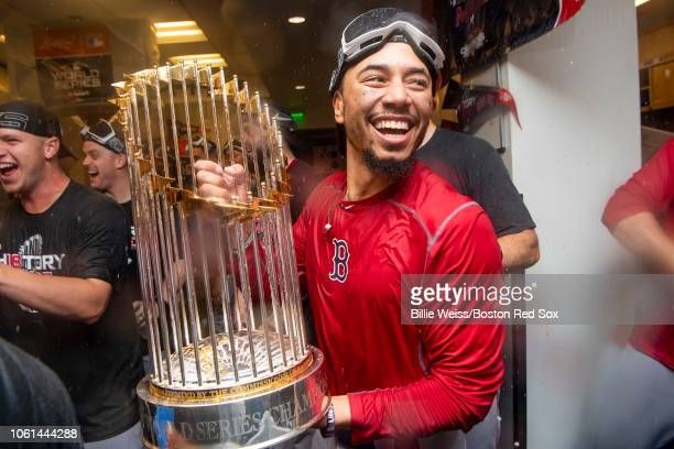 Mookie Betts of the Boston Red Sox celebrates with the World Series trophy after winning the 2018 World Series in game five of the 2018 World Series...
