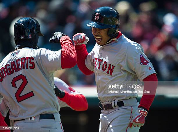 Mookie Betts of the Boston Red Sox celebrates with Xander Bogaerts after hitting a tworun home run gainst the Cleveland Indians in the third inning...