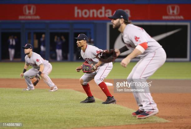 Mookie Betts of the Boston Red Sox comes in from right field and plays on the lip of the infield as the Red Sox emply a five-man infield with the...