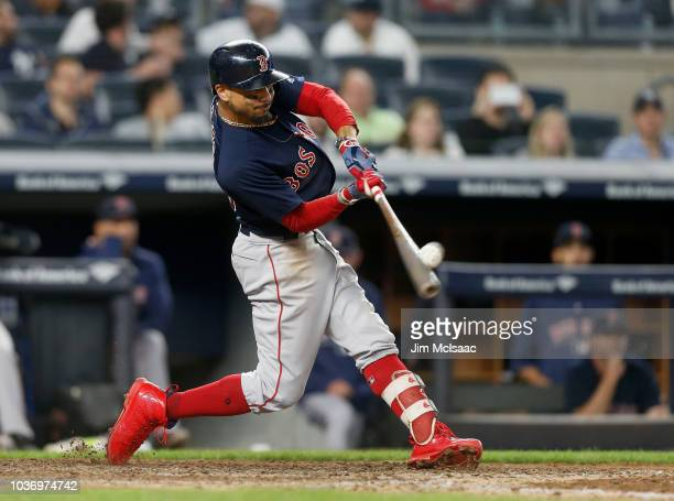 Mookie Betts of the Boston Red Sox connects on an eighth inning three run home run against the New York Yankees at Yankee Stadium on September 20...