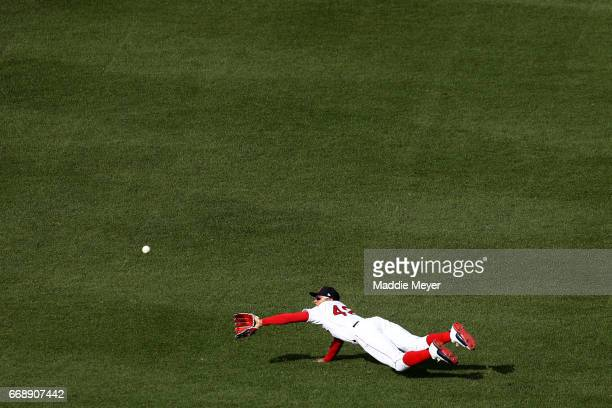 Mookie Betts of the Boston Red Sox dives for a single hit by Logan Morrison of the Tampa Bay Rays during the second inning at Fenway Park on April 15...