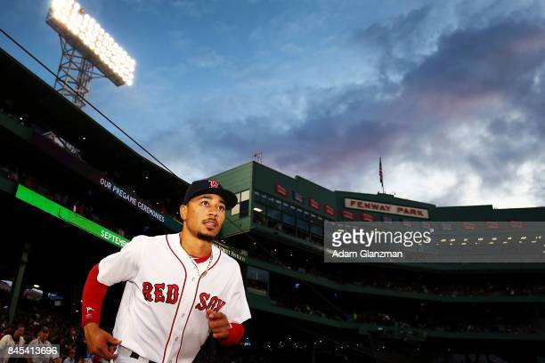 Mookie Betts of the Boston Red Sox enters the field before a game against the Tampa Bay Rays at Fenway Park on September 9 2017 in Boston...