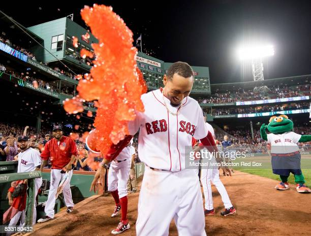 Mookie Betts of the Boston Red Sox gets doused after hitting a gamewinning double against the St Louis Cardinals in the ninth inning on August 16...