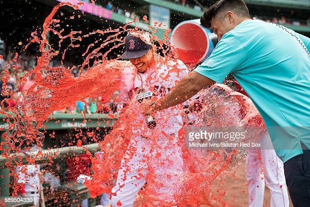 Mookie Betts of the Boston Red Sox gets drenched in powerade after three home run performance lead the Red Sox to a 162 victory and a series sweep...