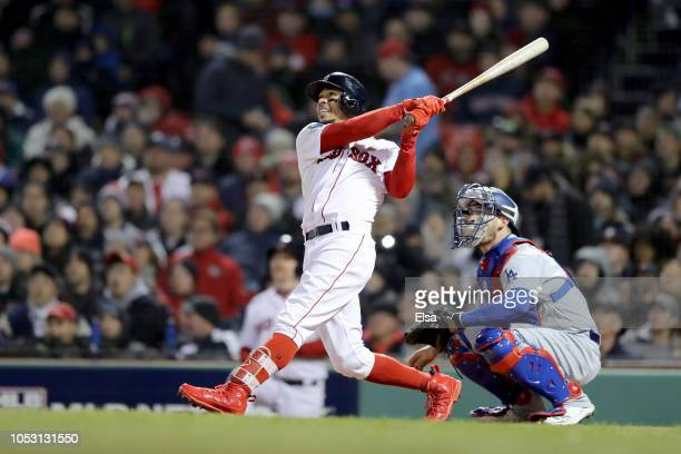 Mookie Betts of the Boston Red Sox hits a double during the seventh inning against the Los Angeles Dodgers in Game Two of the 2018 World Series at...