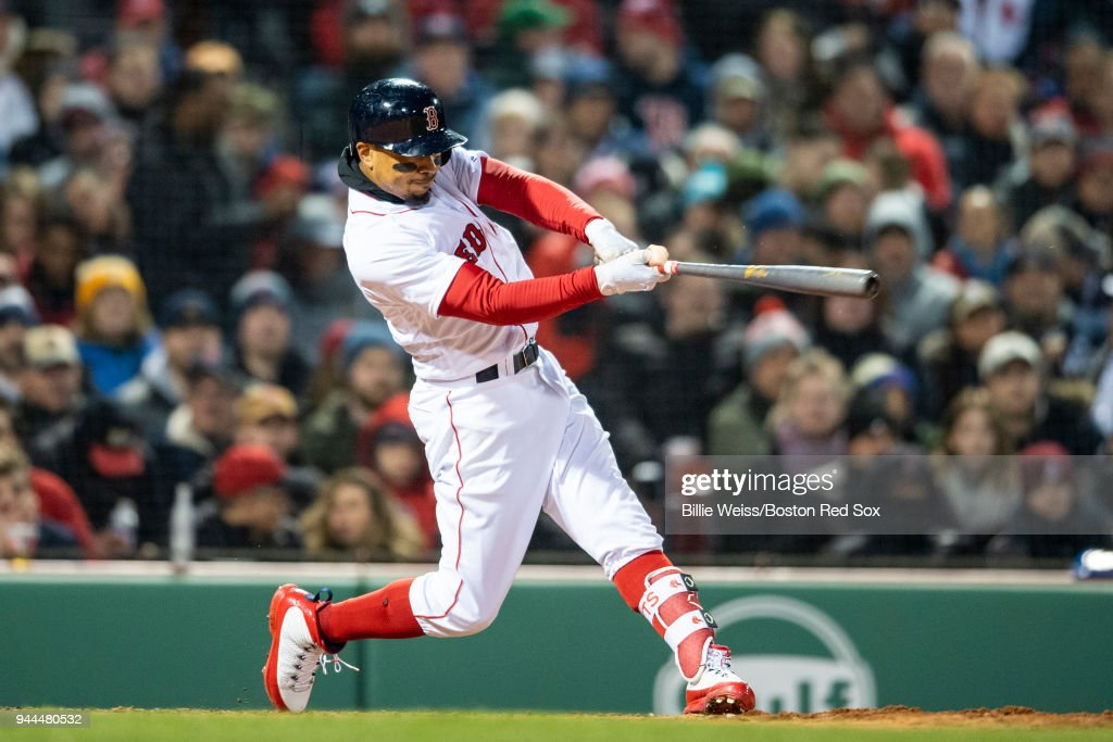 Mookie Betts #50 of the Boston Red Sox hits a grand slam home run during the sixth inning of a game against the New York Yankees on April 10, 2018 at Fenway Park in Boston, Massachusetts.