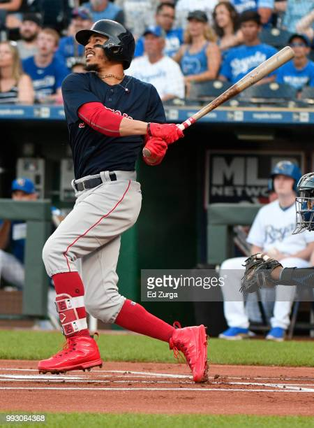 Mookie Betts of the Boston Red Sox hits a home run in the first inning against the Kansas City Royals at Kauffman Stadium on July 6 2018 in Kansas...