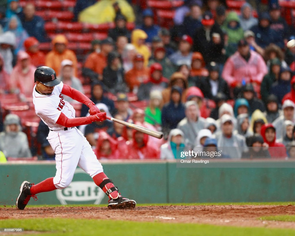 Mookie Betts #50 of the Boston Red Sox hits a single homer in the bottom of the seventh inning during the game against the Houston Astros at Fenway Park on September 30, 2017 in Boston, Massachusetts.