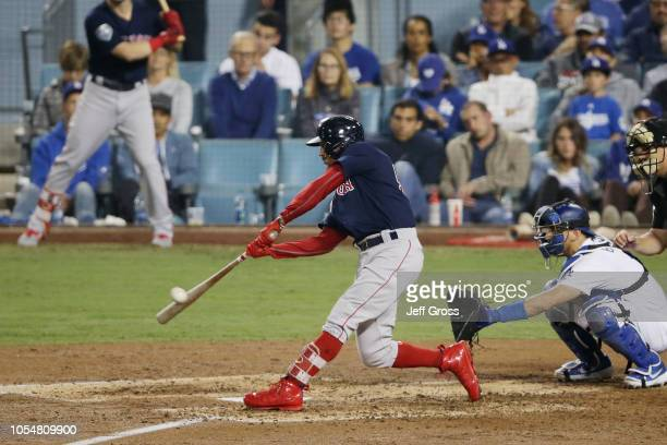 Mookie Betts of the Boston Red Sox hits a sixth inning home run against the Los Angeles Dodgers in Game Five of the 2018 World Series at Dodger...