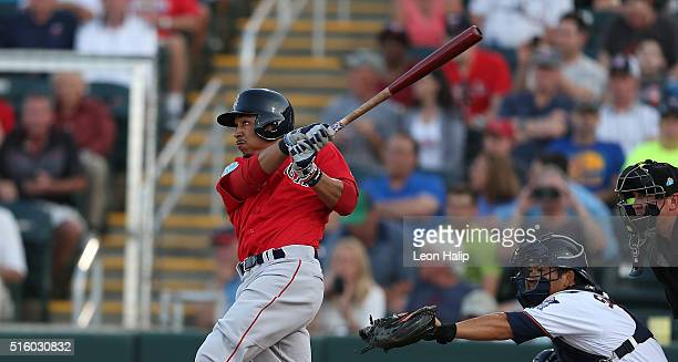 Mookie Betts of the Boston Red Sox hits a solo home run during the first inning of the Spring Training Game against the Minnesota Twins on March 16...