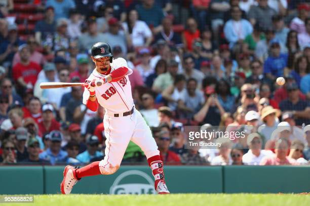 Mookie Betts of the Boston Red Sox hits a solo home run during the seventh inning against the Kansas City Royals at Fenway Park on May 2 2018 in...